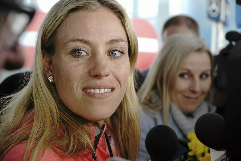 Australian Open winner Angelique Kerber of Germany speaks to the media after her arrival at the airport in Poznan, Poland,  February 1, 2016. Photo: Reuters