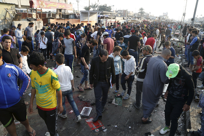 People gather at the site of suicide blasts in Baghdad's Sadr City February 28, 2016. Photo: Reuters
