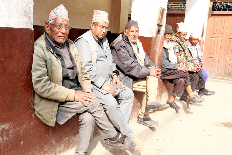 Senior citizens basking in the sun in Madhyapur Thimi-5, Bhaktapur on Friday, February 5, 2016. Photo: RSS