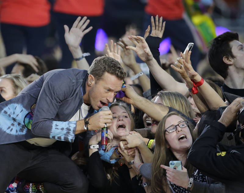 Coldplay singer Chris Martin performs during halftime of the NFL Super Bowl 50 football game Sunday, Feb. 7, 2016, in Santa Clara, Calif. (AP Photo/David J. Phillip)