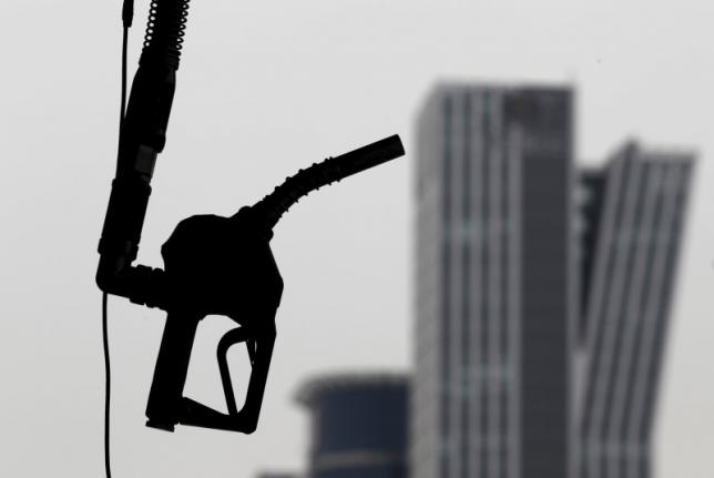 A gasoline pump is seen hanging at a petrol station in central Seoul in this April 6, 2011 file photo. REUTERS/Lee Jae-Won/Files