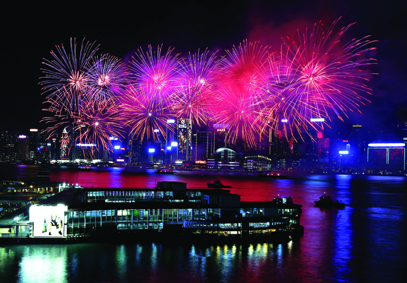 Fireworks explode over the Victoria Harbour of Hong Kong, China, February 9, 2016, to celebrate the Lunar New Year of the Monkey. Photo: Reuters