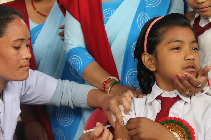 A schoolgirl receives the human papilloma virus (HPV) vaccine at the Kanya Higher Secondary School in Pokhara, on Friday, February 26, 2016. A campaign has started in Kaski and Chitwan districts to vaccinate girls from the age of 9 to 13 as a prevention measure against endometrical cancer. Photo: Bharat Koirala