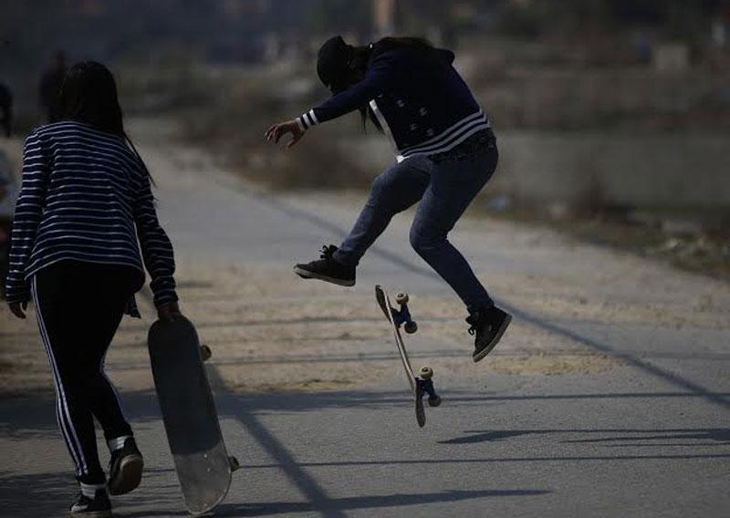 A girl performs an incredible skateboard trick in Chyasal of Lalitpur, on Tuesday, February 23, 2016. Photo: Skanda Gautam