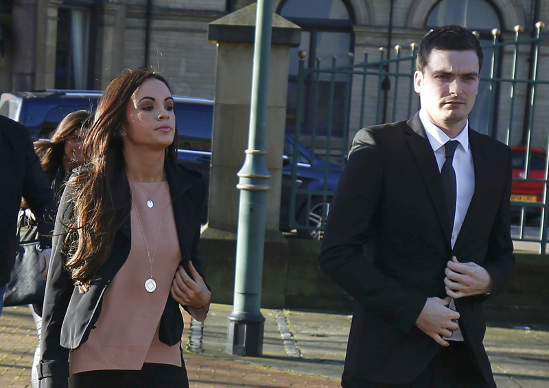 Sunderland soccer player Adam Johnson (right) arrives with his girlfriend Stacey Flounders at Bradford Crown Court in Bradford, Britain February 10, 2016. Photo: Reuters