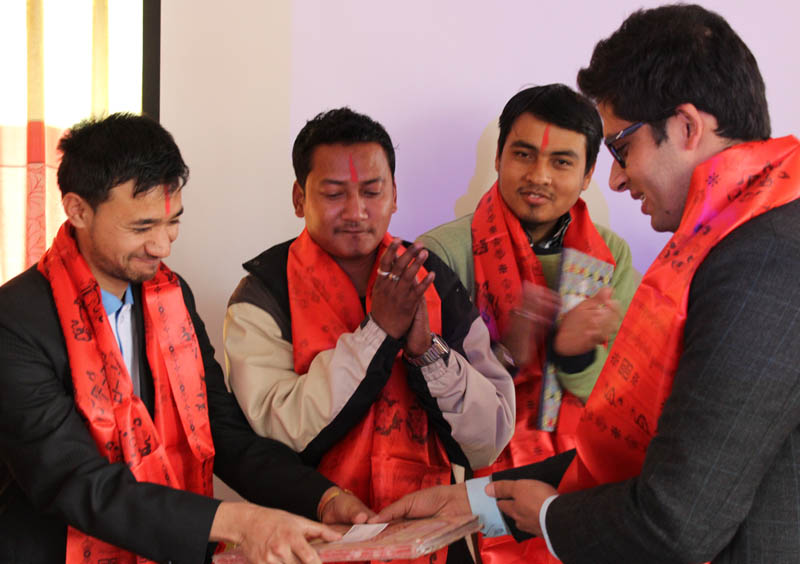 Yuwalaya outgoing President Subash Neupane (right) handing over the minutes to newly elected President Sanjog Thakuri, during its general convention, in Lalitpur, on Saturday, February 27, 2016. Photo: Yuwalaya