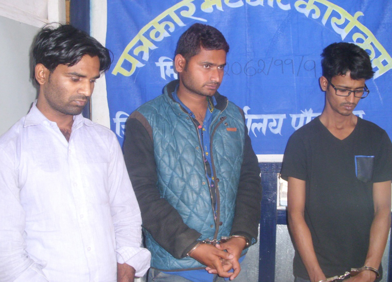 Police making three swindlers public for their involvement in cheating locals through the Ncell app, at a  press meet, in Panchthar District Police Office, on Wednesday, March 2, 2016. Photo: THT