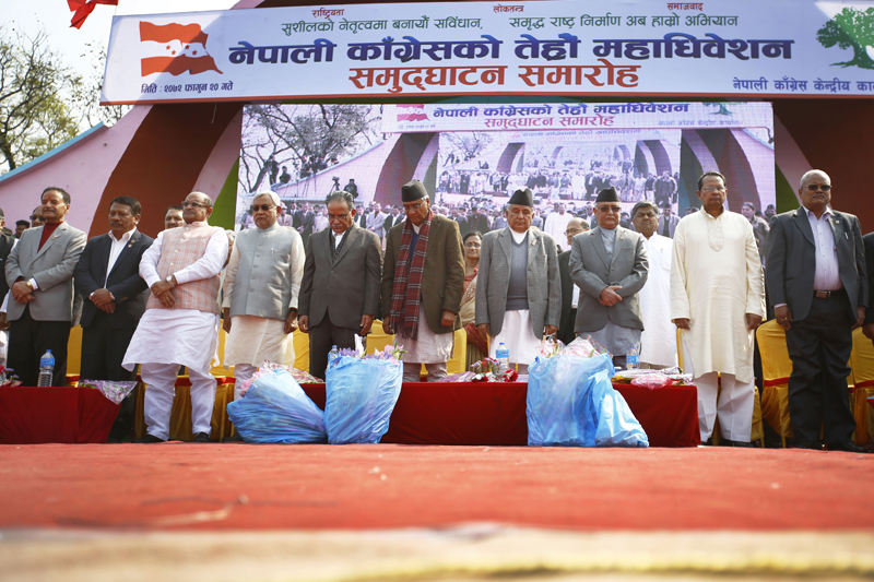 Nepal's Prime Minister KP Sharma Oli (3rd from right) along with Chief Minister of Bihar state of India Nitish Kumar (4th from left) and other foreign delegates and top leaders attend the inaugural session of the 13th general convention of the Nepali Congress party in Khulamanch, Kathmandu, on Thursday, March 3, 2016. Photo: Skanda Gautam