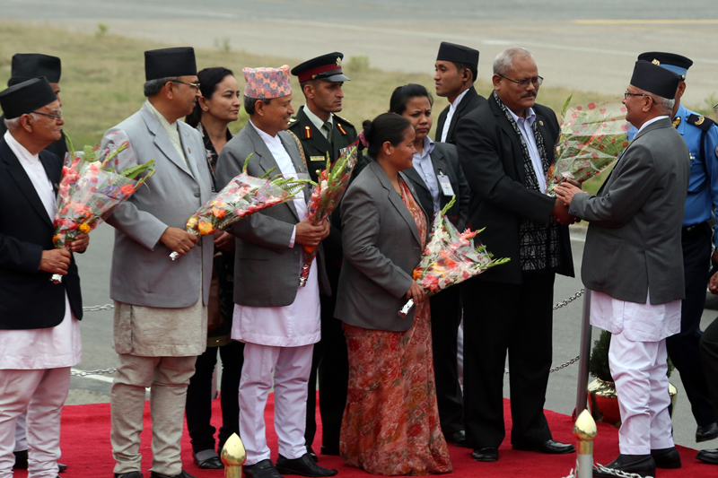 Acting Prime Minister Bijay Kumar Gachhadar among other dignitaries welcomes Prime Minister KP Sharma Oli, who returned from his official China visit, at the Tribhuvan International Airport, in Kathmandu, on Sunday, March 27, 2016. Photo: RSS