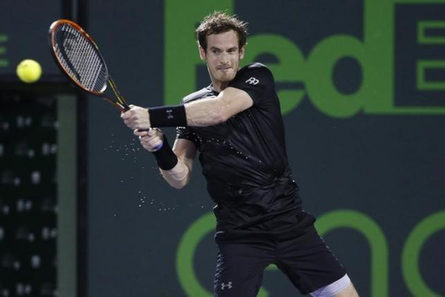 Mar 26, 2016; Key Biscayne, FL, USA; Andy Murray hits a backhand against Denis Istomin (not pictured) on day five of the Miami Open at Crandon Park Tennis Center. Murray won 6-3, 7-5. Geoff Burke-USA TODAY Sports