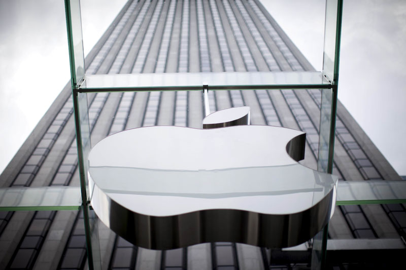 An Apple logo hangs above the entrance to the Apple store on 5th Avenue in New York City, in this file photo taken July 21, 2015. Photo: Reuters
