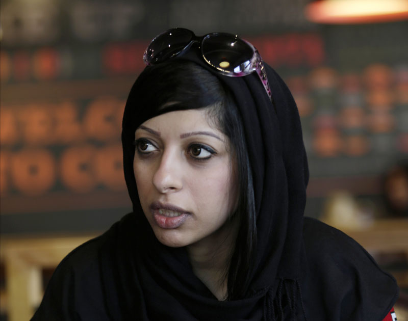 FILE - Bahraini opposition activist Zainab al-Khawaja checks her cellphone as she waits to hear about her detained sister, Maryam al-Khawaja, outside the court in Manama, Bahrain, on Saturday, September 6, 2014. Photo: AP