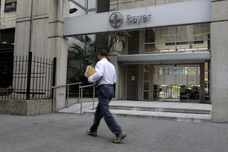 A man walks in front of the Bayer headquarters building in Caracas in this photo taken on March 1, 2016. Photo: Reuters