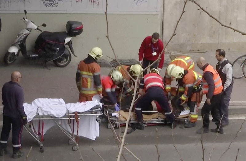 The videograb shows, emergency rescue workers stretcher an unidentified person at the site of an explosion at a metro station in Brussels, Belgium, on Tuesday, March 22, 2016. Photo: APTN via AP