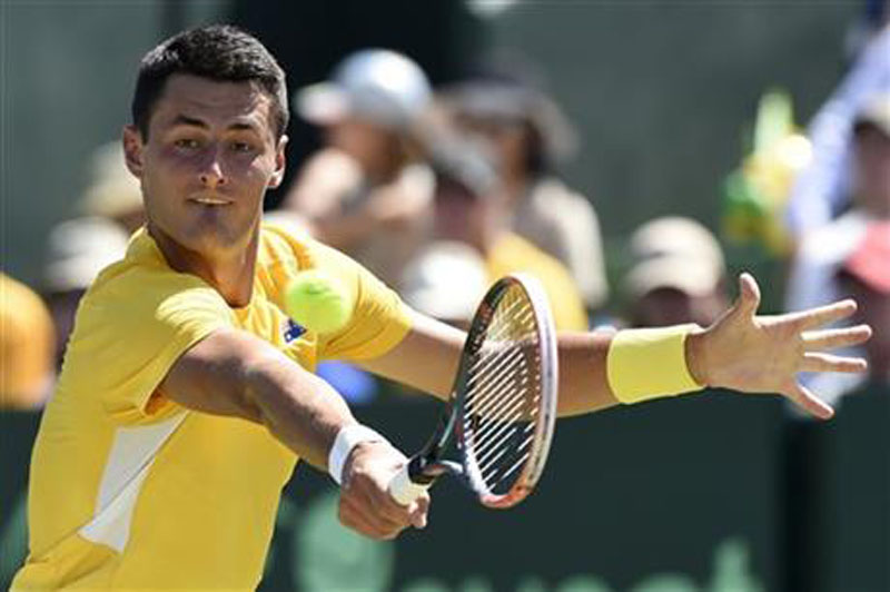 Australia's Bernard Tomic makes a backhand return to United States' Jack Sock during their Davis Cup singles match in Melbourne, Australia, Friday, March 4, 2016. Photo: AP