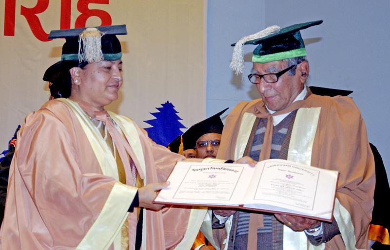 President Bidhya Devi Bhandari awarding the honorary DLitt  to Rastra Kabi Madhav nPrasad Ghimire during a special convocation ceremony of Tribhuvan University, nat City Hall, in Kathmandu, on Monday, March 14, 2016. Photo: Bal Krishna Thapa Chhetri/THT