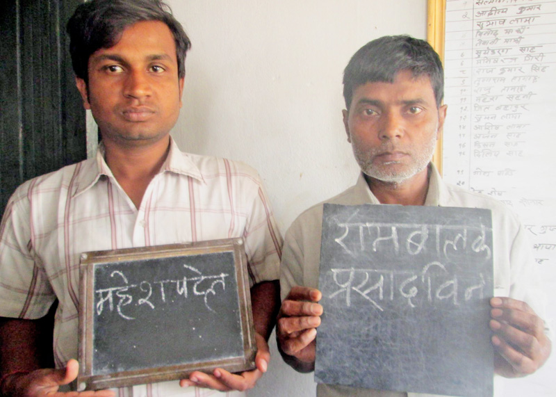 Two alleged extortionists being paraded at Parsa District Police Office on Wednesday, March 2, 2016. Photo: Ram Sarraf