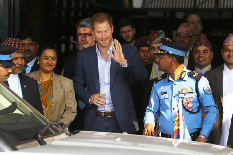 Prince Harry waves to a gathering of people upon his arrival at the Tribhuvan International Airport (TIA) in the Capital on Saturday, March 19, 2016. Photo: Skanda Gautam
