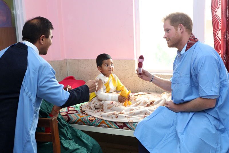 Visiting British Prince Harry interacts with a patient at the Burns Ward of Kanti Children's Hospital in Kathmandu, on Wednesday, March 23, 2016. Photo: RSS