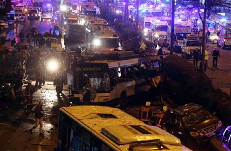 Emergency services work at the explosion site in the busy center of Turkish capital, Ankara, Turkey, Sunday, March 13, 2016. The explosion is believed to have been caused by a car bomb that went off close to bus stops. Photo: AP