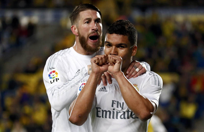 Real Madrid's Casemiro celebrates with teammate Sergio Ramos after scoring a goal against Las Palmas in Las Palmas during their La Liga match on Sunday. Photo: Reuters