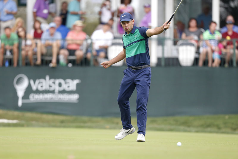 Charl Schwartzel, of South Africa, reacts as he watches his putt about to drop for birdie on the 17th hole during the final round of the Valspar Championship golf tournament on Sunday, March 13, 2016, in Palm Harbor, Florida. Photo: AP