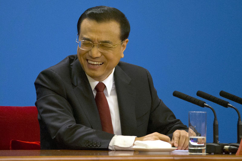 Chinese Premier Li Keqiang reacts during a press conference after the closing session of the annual National People's Congress held in Beijing's Great Hall of the People on Wednesday, March 16, 2016. Photo: AP