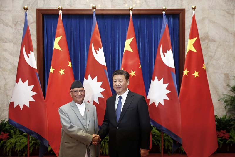Chinese President Xi Jinping (right) shakes hands with Prime Minister Khadga Prasad Oli (left) inside the Great Hall of the People Monday, on March 21, 2016 in Beijing, China. Photo: Lintao Zhang via AP
