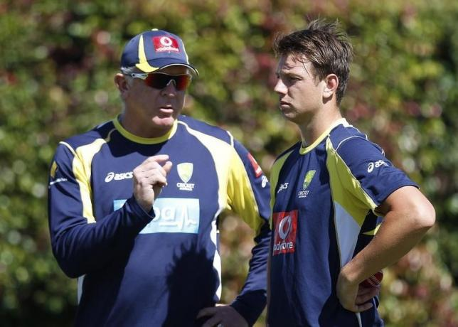 Australia's bowling coach Craig McDermott (L) talks to fast bowler James Pattinson during a practice session at the Sydney Cricket Ground January 2, 2012. REUTERS/Tim Wimborne/Files