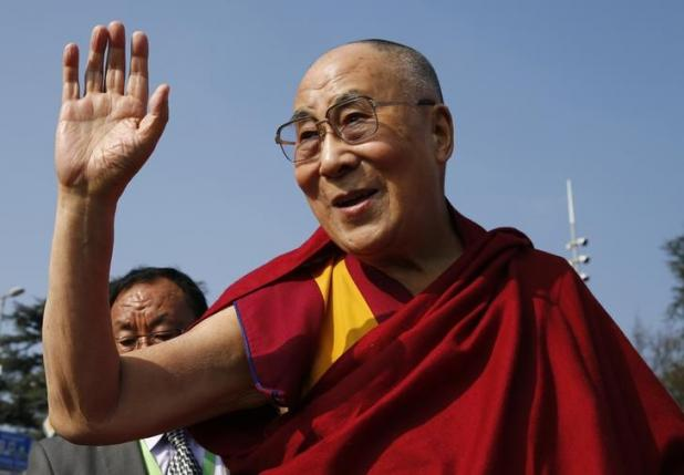 Tibetan spiritual leader the Dalai Lama waves to devotees outside the United Nations where the Human Rights Council is holding it's 31st Session in Geneva, Switzerland, March 11, 2016.  Photo: Reuters