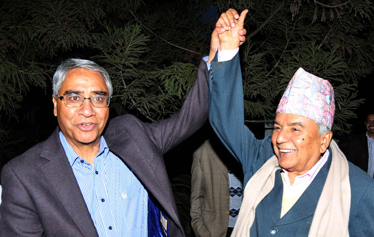 Sher Bahadur Deuba, who has been elected the president of Nepali Congress, and Ram Chandra Paudel, the acting president of the party, share a light moment at a reception held by the latter to welcome the CWC members and office bearers elected by the party's general convention on March 15, 2016. Photo: RSS