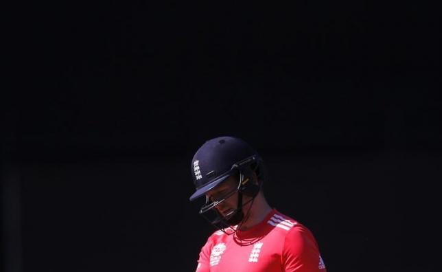 Cricket - England v Afghanistan - World Twenty20 cricket tournament - New Delhi, India, 23/03/2016. England's captain Eoin Morgan walks off the field after his dismissal. REUTERS/Adnan Abidi