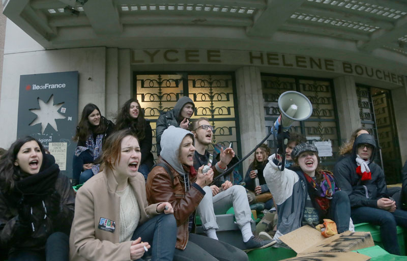 Students  shout slogans outside their high school in Paris, on Wednesday , March 9, 2016. Photo: AP