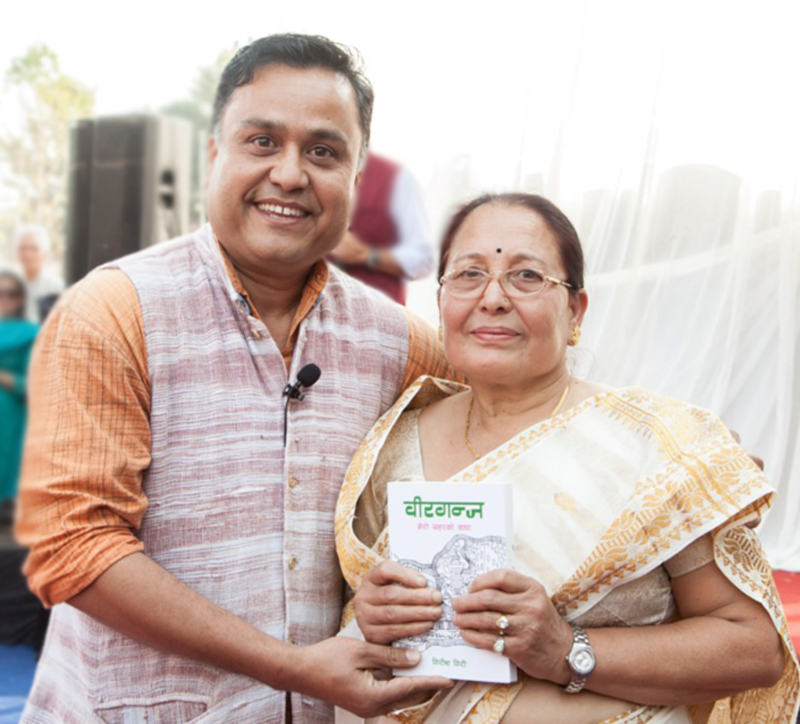 Journalist and documentary maker Girish Giri's book 'Birgunj: Mero Saharko Katha' being launched by his mother Sashi Giri at Dabali of Nepal Academy on Friday, March 11, 2016. Photo: Napalaya