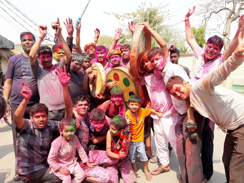 Locals pose for a photograph while  celebrating Holi, the festival of colours, in Birgunj on Wednesday, March 23, 2016. Photo: Ram Sarraf