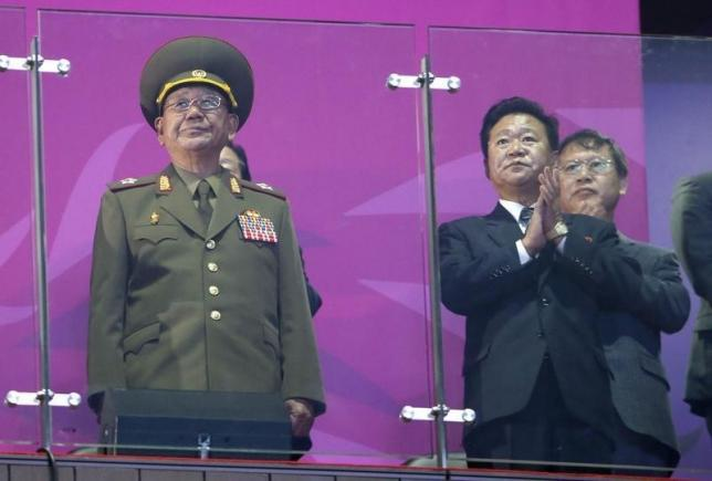 North Korea's Hwang Pyong So (L), a senior aide North Korea's supreme leader Kim Jong Un, attends the closing ceremony of the 17th Asian Games at the Incheon Asiad Main Stadium, October 4, 2014. REUTERS/Jason Reed/Files