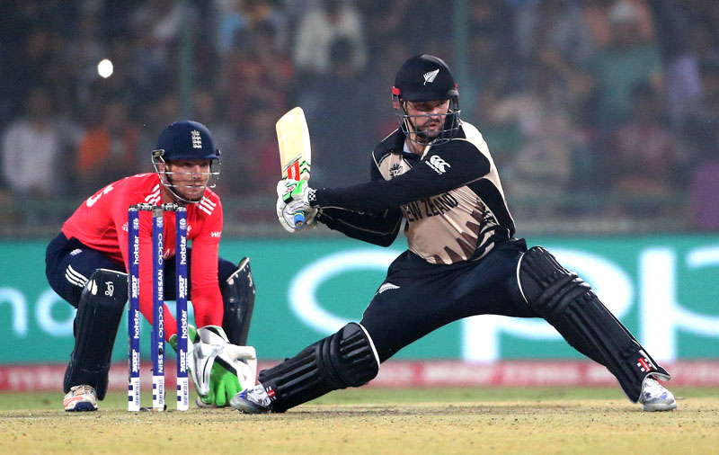 New Zealand's Colin Munro plays a shot during their ICC Twenty20 2016 Cricket World Cup semifinal match against England at the Feroz Shah Kotla Cricket Stadium in New Delhi, India, on Wednesday, March 30, 2016. Photo: AP