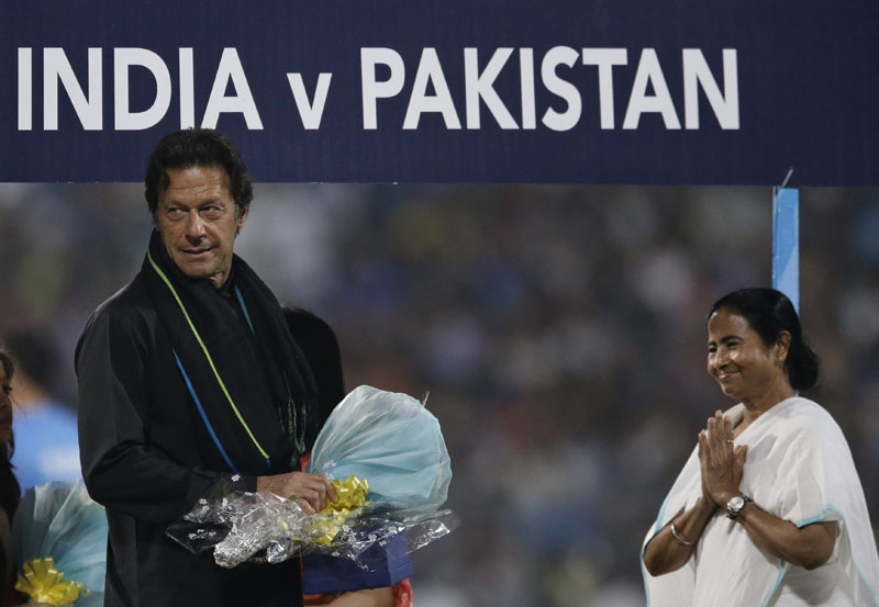 Pakistan's former captain Imran Khan (left) receives flowers from West Bengal state Chief Minister Mamata Banerjee ahead of the ICC World Twenty20 2016 cricket match between India and Pakistan at Eden Gardens, Kolkata, India, on Saturday, March 19, 2016. Photo: AP
