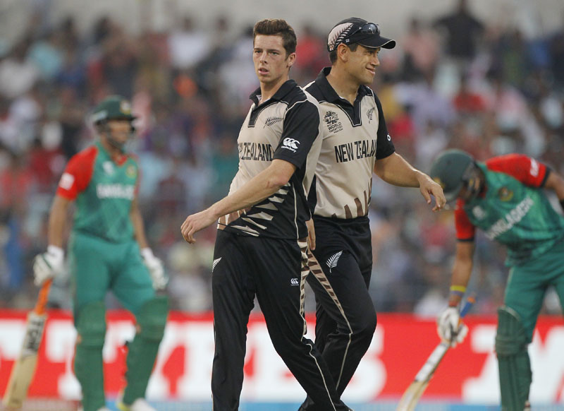 New Zealand's Mitchell Santner and Ross Taylor (right), celebrate the dismissal of a Bangladesh batsman during their match at the ICC World Twenty20 2016 cricket tournament in Kolkata, India, on Saturday, March 26, 2016. Photo: AP