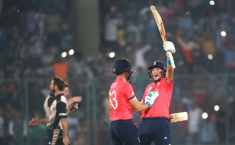 England's Joe Root (right) and teammate Jos Buttler celebrate after defeating New Zealand during their ICC Twenty20 2016 Cricket World Cup semifinal match at the Feroz Shah Kotla Cricket Stadium in New Delhi, India, on Wednesday, March 30, 2016. Photo: AP