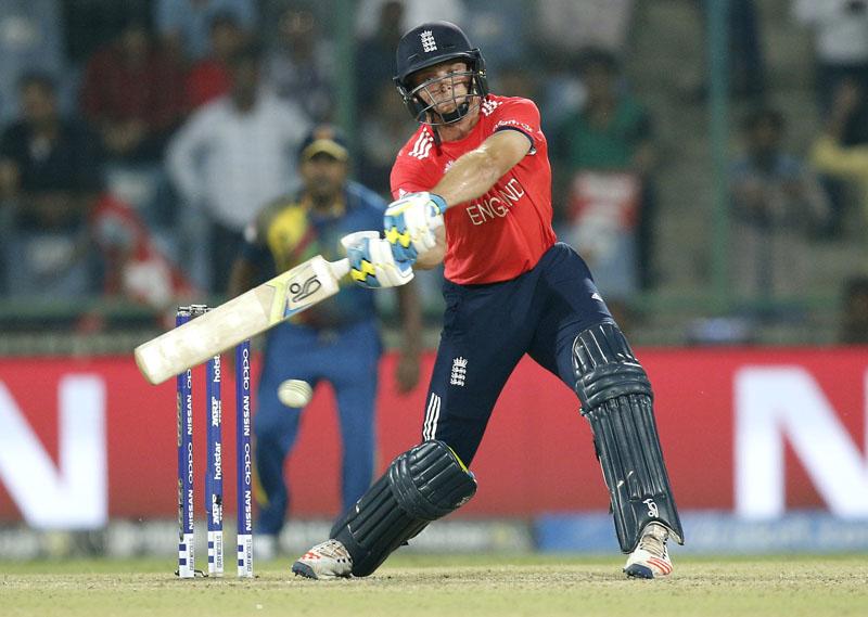 England's Jos Buttler bats during their ICC World Twenty20 2016 cricket match against Sri Lanka at the Feroz Shah Kotla cricket stadium in New Delhi, India, on Saturday, March 26, 2016. Photo: AP /Tsering Topgya