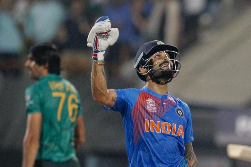 India's Virat Kohli celebrates after India won the ICC World Twenty20 2016 cricket match against Pakistan at Eden Gardens in Kolkata, India, Saturday, March 19, 2016. India won by six wickets. Photo: AP