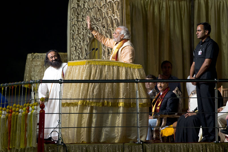Indian Prime Minister Narendra Modi (second left) waves to delegates during the inauguration of a massive cultural festival on the banks of the river Yamuna, in New Delhi, India, on Friday, March 11, 2016. Photo: AP