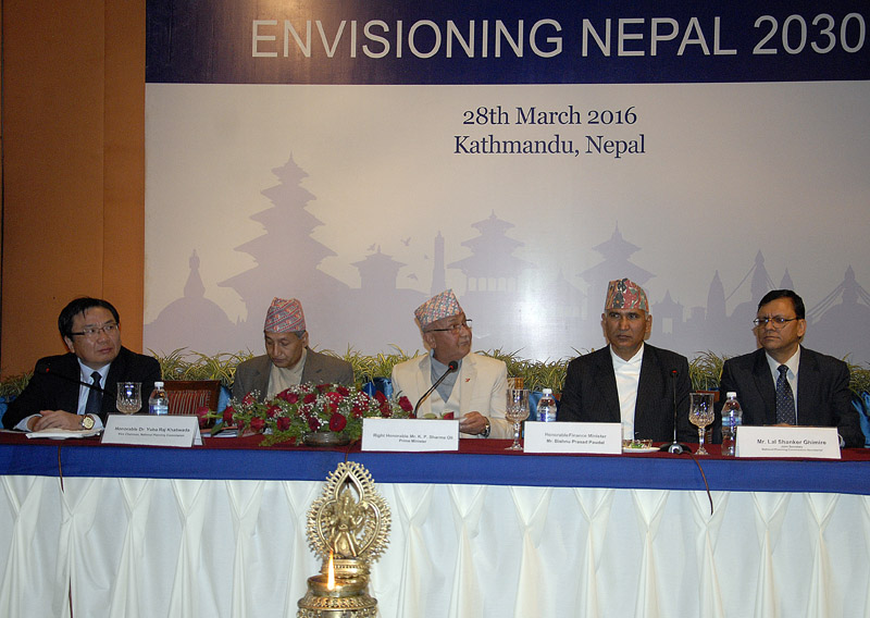 (From left) ADB Vice President Wencai Zhang, Vice Chairman of NPC Yubaraj Khatiwada, Prime Minister KP Sharma Oli, Finance Minister Bishnu Prasad Paudel and Joint Secretary at NPC Lal Shanker Ghimire, during International Conference on Envisioning Nepal 2030, in Kathmandu, on Monday. PHOTO:THT