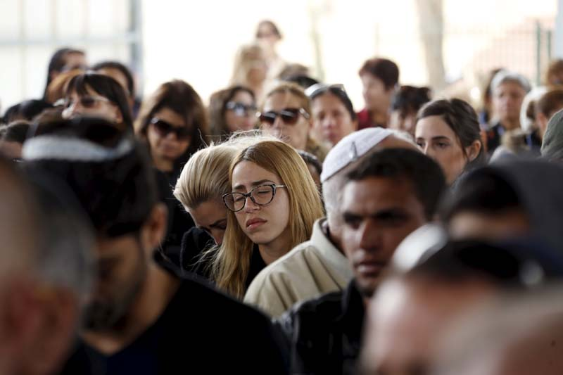 Relatives and friends mourn during the funeral of Simcha Damari (60) one of three Israel citizens killed in a suicide bombing attack in Istanbul on Saturday, in Dimona, southern Israel on March 21, 2016. Photo: Reuters