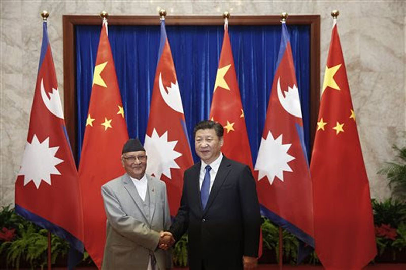 Prime Minister KP Sharma Oli shakes hands with Chinese President Xi Jinping at the Great Hall of the People Monday, March 21, 2016. Photo: (Lintao Zhang/Pool Photo via AP)