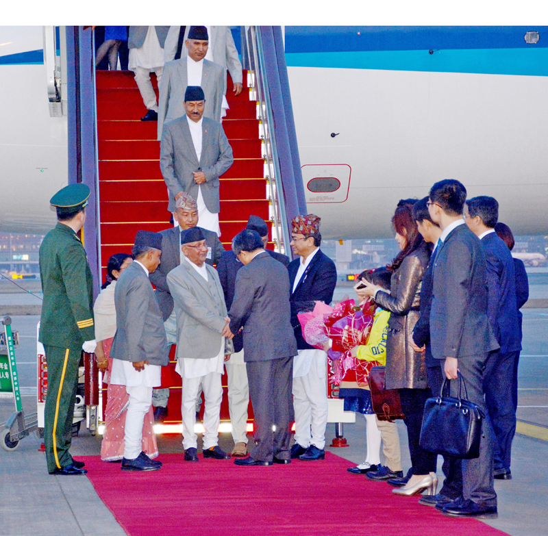 Prime Minister KP Sharma Oli, who embarked on an official week-long visit to China at the invention of Chinese premier, being welcomed by Chinese Vice Foreign Minister Liu Zhenmin  as PM lands in Beijing on Sunday, March 20, 2016. Photo: RSS