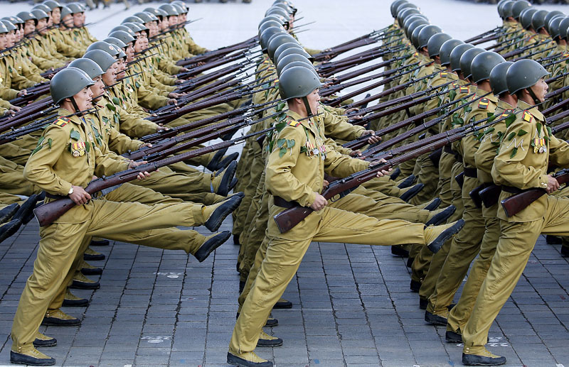 North Korean soldiers march across the Kim Il Sung Square during a military parade in Pyongyang, North Korea, on Saturday, October 10, 2015. Photo: AP/Wong Maye-E