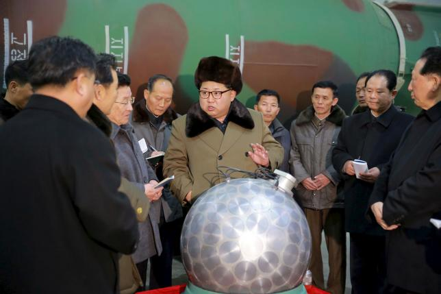 North Korean leader Kim Jong Un meets scientists and technicians in the field of research into nuclear weapons in this undated photo released March 9, 2016. REUTERS/KCNA