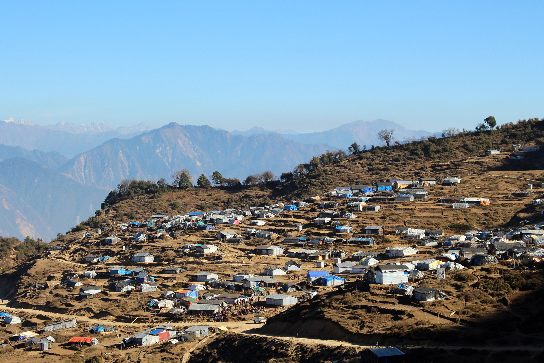 Wrecked makeshift shelters of earthquake victims as seen from Gupsipakha of Laprak, Gorkha, on Tuesday, March 15, 2016. Life of earthquake victims has become miserable after the thunderstorm blew off the roofs of their temporary shelters. Photo: RSS